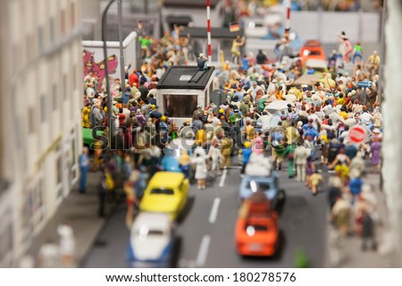 Miniature town with many people - stock photo