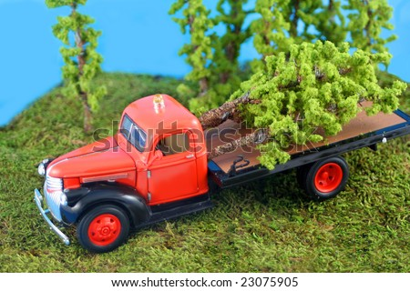 miniature truck with cut down trees