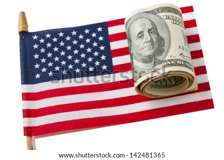 Miniature  version of American Flag and roll of american hundred dollars bills.