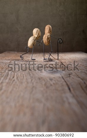 Miniature with old couple walking together