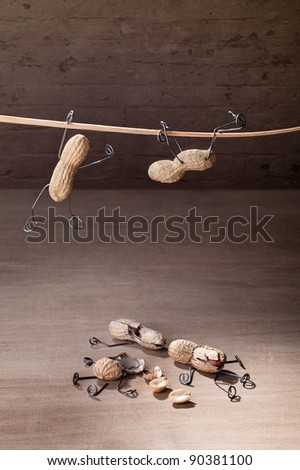 Miniature with Peanut People trying to hold their balance and grasping for a straw