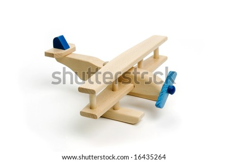 Miniature wood airplane isolated on white