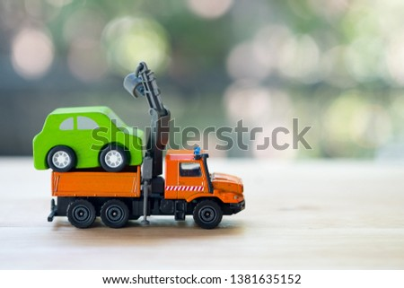 Miniature wooden car on truck transports. The truck transports service move and repair car #1381635152