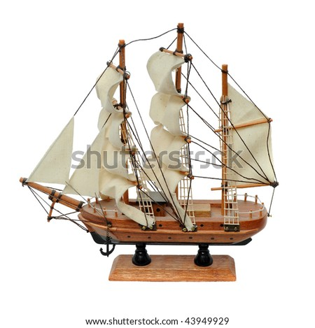 Miniature wooden model of a sail ship isolated on white background - stock photo