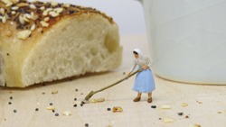 Miniature Worker sweeping up crumbs from Everything Bagel