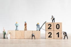 Miniature worker team create number 2021 and remove number 2020  , Happy new year  concept