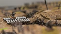 miniatures used in terrain for combat tactics reproduction