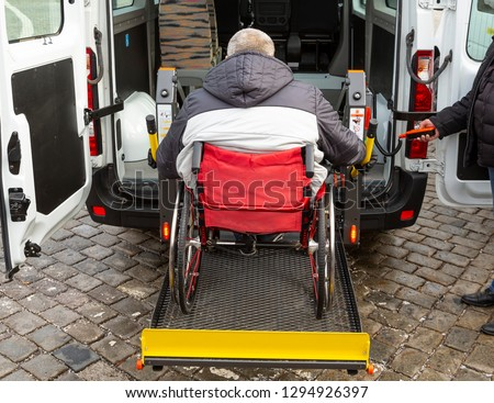 Minibus for handicapped, physically challenged and disabled people in wheelchairs. Minibus with stowed wheelchair ramp.