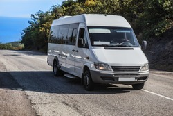 Minibus Moves on the road from the sea in summer