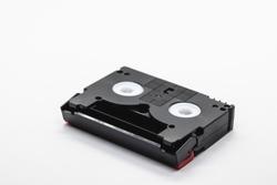 MiniDV format video cassette tape isolated on white background.
