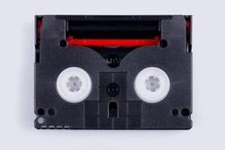 MiniDV tape for magnetic tape video cameras isolated on white.