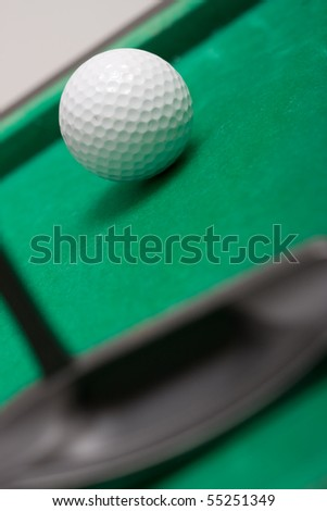 Minigolf - golf ball and a putter