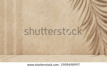 Minimal abstract concrete texture background for cosmetic product presentation. Premium podium with tropical palm leaf shadow on beige natural stone wall. Realistic 3d rendering