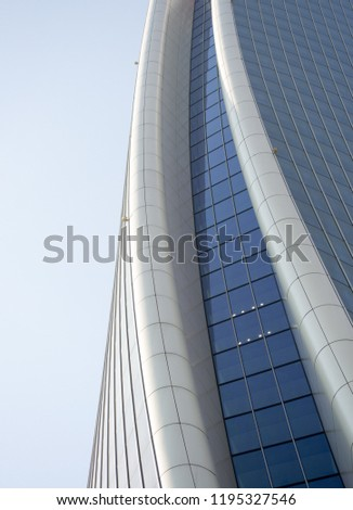 """Minimal architectural view of the curved shapes of a nice modern building located in Milan, in the new """"city life district"""""""