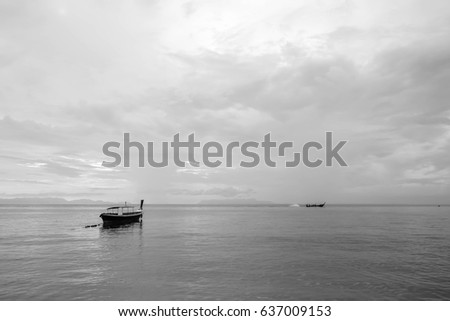 Minimal boat and sea with sky black and white background #637009153
