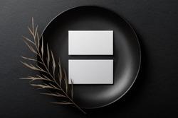 Minimal business card mockup on black plate
