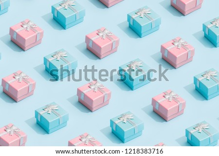 Minimal composition background of pastel pink and blue Christmas gift box. New Year concept.
