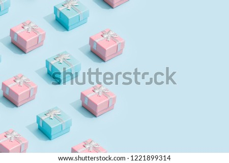 Minimal composition background of pastel pink and blue Christmas gifts. New Year concept.