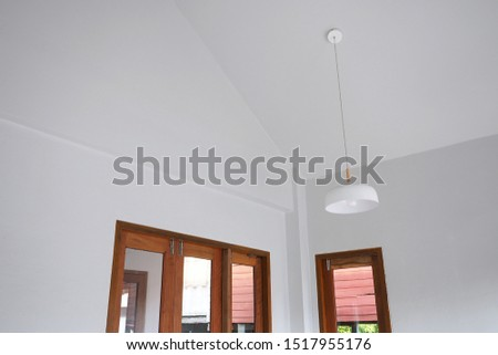 Minimal contemporary house design. White interior space with wooden window and white pendant. #1517955176