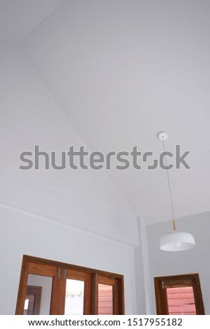Minimal contemporary house design. White interior space with wooden window and white pendant. #1517955182