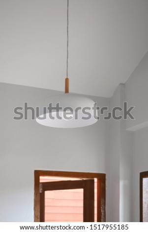 Minimal contemporary house design. White interior space with wooden window and white pendant. #1517955185