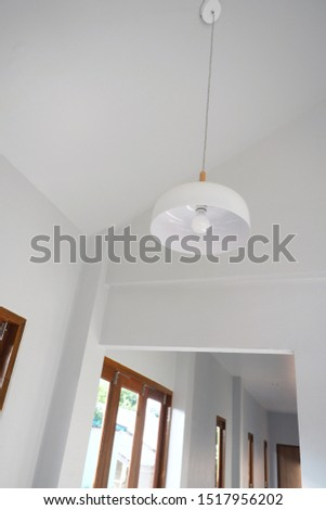 Minimal contemporary house design. White interior space with wooden window and white pendant. #1517956202