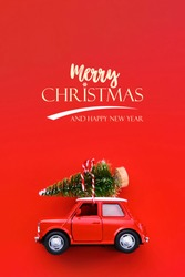 Minimal design for celebrating christmas or new year greeting card. Gift delivery concept. Little red toy car and Christmas tree on a red background