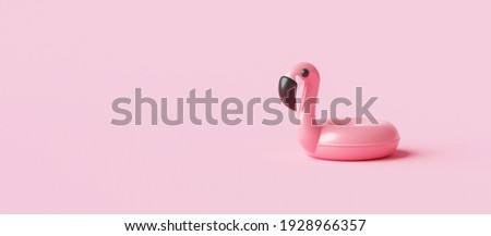 Minimal flamingo inflatable swimming pool ring and summer season on pink background with tropical holiday concept. 3D rendering. Сток-фото ©