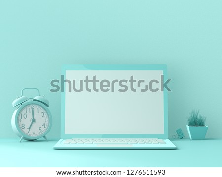 minimal idea concept, Laptop  mock-up on Work desk with clock, binder clip and Small tree blue color on blue background. 3d render.