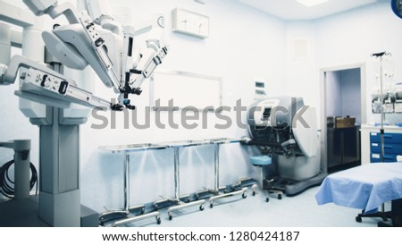Minimal invasive robot surgical system in hospital. Robotic technology equipment, machine arm surgeon in futuristic operation room. Medical inovation 3D view endoscopy for robot surgery in healthcare