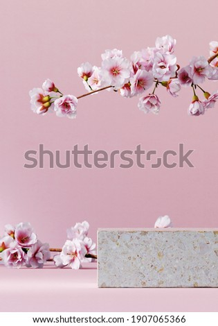 Minimal mockup background for product presentation. Stone podium and cherry blossom flower on pink background. Clipping path of each element included. 3d rendering illustration.