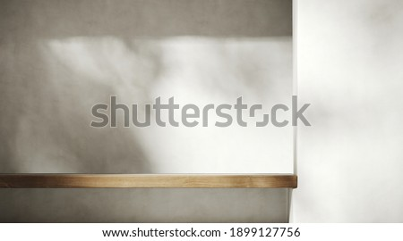 Minimal mockup background for product presentation. Wood shelf on plaster wall with leaf shadow. Clipping path of each element included. 3d rendering illustration.