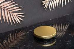 Minimal modern product display on black and golden palm leaves on background with podium, luxury 20s art deco style