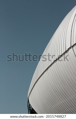 Minimal photo of stadium with blue clear sky during day