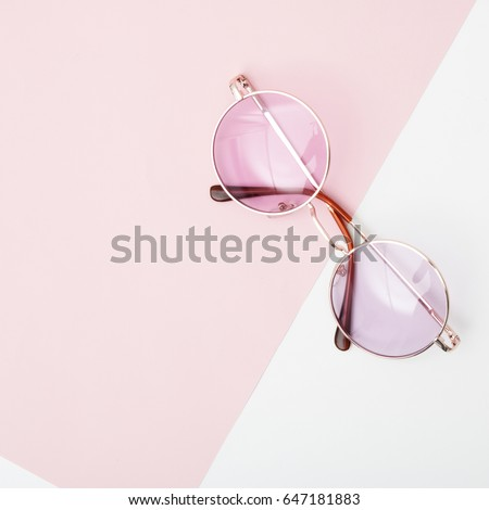 Minimal style. Minimalist fashion photography. Vintage. Glamour. Pink sunglasses on pastel backgrounds. Flat lay