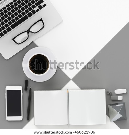 Minimal work space : grey tone , laptop , coffee latte , eyeglasses , pen , notepad , smart phone ,  tablet  on grey background for copy space , flat lay , top view #460621906