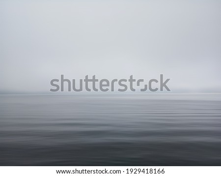 Minimalism scene of misty morning background in the sea. Fog over lake wave water. Calm beach view. Tranquil empty landscape with soft blue gray gloomy sky. Nature abstract art backgrounds. Copy space Сток-фото ©