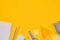 minimalism yellow-blue stationery on yellow background school, university, flat layer, copy space