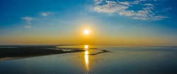 Minimalist aerial seascape - sunset over calm water. Baltic Sea.