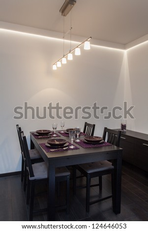 Minimalist apartment - table prepared for a party
