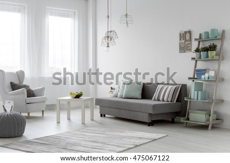 Minimalist arrangement in trendy bright mint flat interior