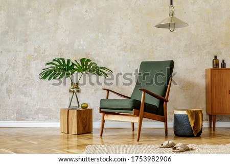 Minimalist concept of home interior with retro armchair, pendant lamp, wooden commode, tropical leaf in vase, wooden cube, carpet, basket and elegant accessories in modern home decor. Foto stock ©