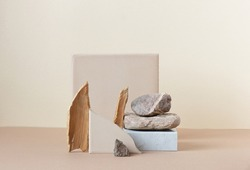 Minimalist monochrome still life composition with  natural nature materials: stone, marble, earthy clay and plant dry branch in beige color, copy space, abstract modern art design concept
