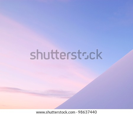 Minimalist photo of snow against sky at sunset.