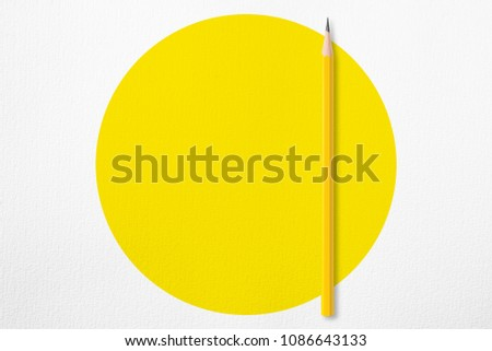 Minimalist presentation template with copy space by top view close up photo of yellow pencil isolated on white paper and combine with yellow circle shape. Flash light made soft light on yellow pencil. #1086643133