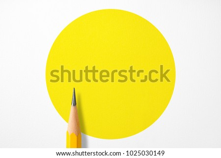 Minimalist template with copy space by top view close up macro photo of wooden yellow pencil isolated on white texture paper and combine with yellow circle. Flash light made smooth shadow from pencil. #1025030149