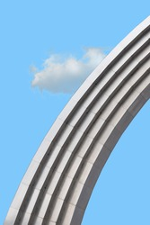 Minimalist urban geometry.  Arch with a cloud and a blue sky.  Can be used to decorate the interior.