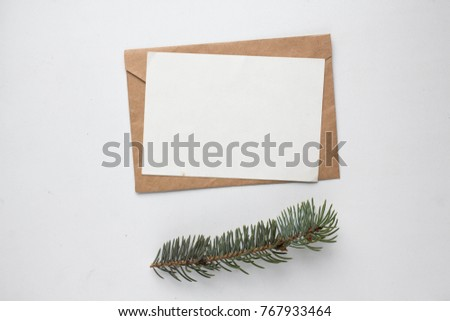 Minimalistic Christmas card mockup with fir branch, cone, envelope