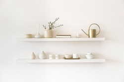 Minimalistic. Cozy light home style. Scandinavian interior. Dishes on white shelves. White details in the interior.