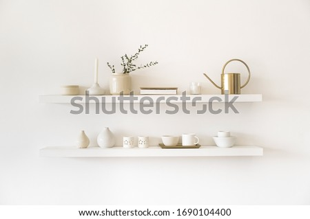 Minimalistic. Cozy light home style. Scandinavian interior. Dishes on white shelves. White details in the interior.  Foto stock ©